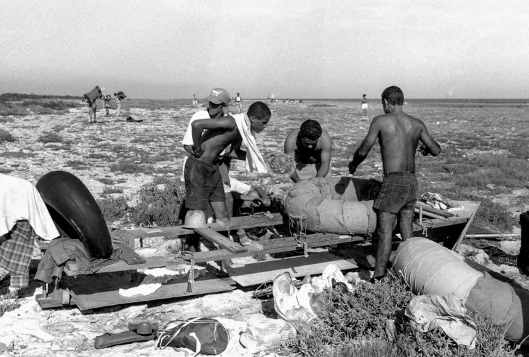 People prepare to launch a makeshift boat into the Straits of Florida towards the U.S., on the last day of the 1994 Cuban raft exodus in Havana, September 13, 1994. (REUTERS/Rolando Pujol Rodriguez)