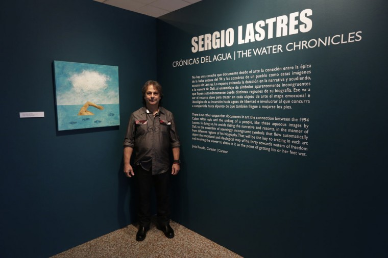 Former Cuban rafter Sergio Lastres, 49, poses at an exhibition of his work based on the 1994 Cuban raft exodus in Miami on September 19, 2014. Lastres and his wife were among 15 migrants rescued when their raft filled with water in 1994. They were taken to Guantanamo Base where he painted his first work about rafters, he said. (REUTERS/Enrique de la Osa)