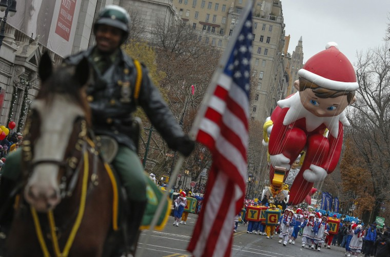 The Elf on the Shelf balloon floats down Central Park West during the 88th Macy's Thanksgiving Day Parade in New York. (REUTERS/Eduardo Munoz)