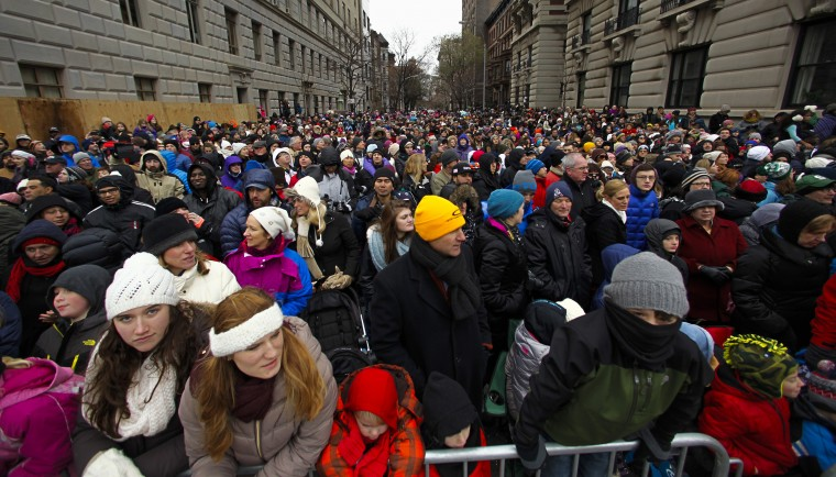 People try to watch the 88th Macy's Thanksgiving Day Parade in New York. (REUTERS/Eduardo Munoz)