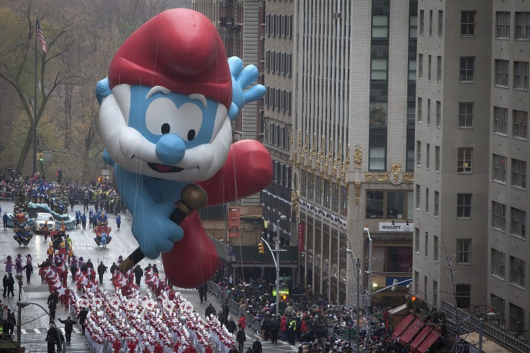 The Papa Smurf float makes its way down 6th Ave during the Macy's Thanksgiving Day Parade, in New York. (REUTERS/Carlo Allegri)