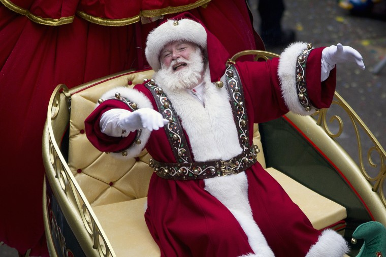 A Santa Claus character reacts as he makes his way down 6th Ave during the Macy's Thanksgiving Day Parade in New York. (REUTERS/Carlo Allegri)