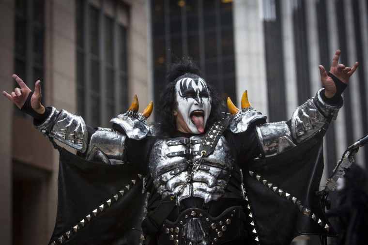 Gene Simmons of KISS greets spectators during the 88th Annual Macy's Thanksgiving Day Parade in New York. (REUTERS/Andrew Kelly)