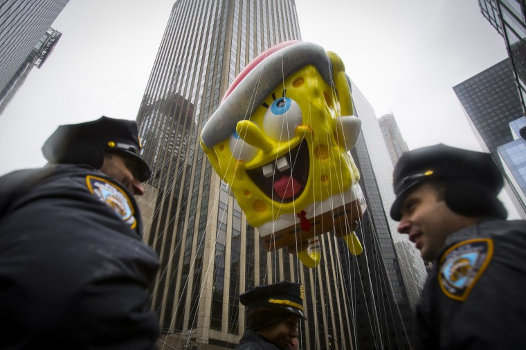 The Spongebob Squarepants balloon floats by New York Police Officers during the 88th Annual Macy's Thanksgiving Day Parade in New York. (REUTERS/Andrew Kelly)