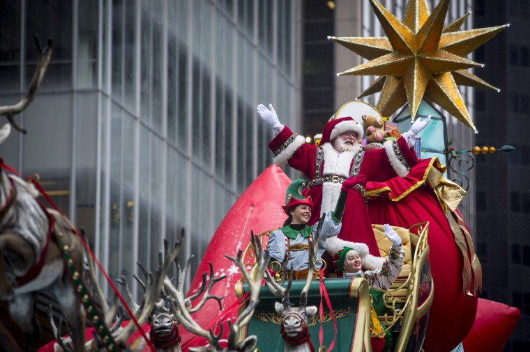 A man dressed as Santa Claus waves during the 88th Annual Macy's Thanksgiving Day Parade in New York. (REUTERS/Andrew Kelly)