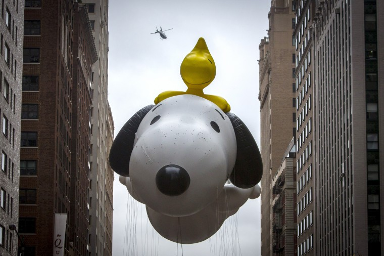 The Snoopy balloon floats down Sixth Avenue during the 88th Annual Macy's Thanksgiving Day Parade in New York. (REUTERS/Andrew Kelly)