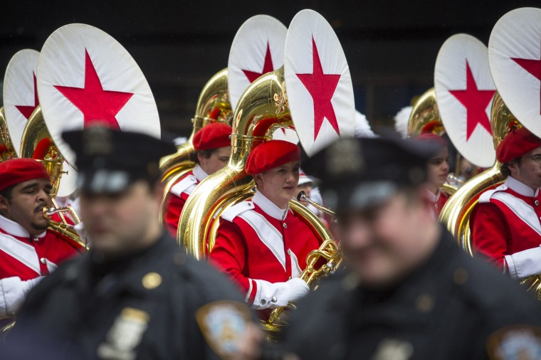 New York Police Officers stand by as a marching band walks down Sixth Avenue during the 88th Annual Macy's Thanksgiving Day Parade in New York. (REUTERS/Andrew Kelly)
