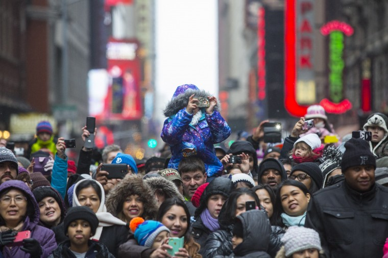 Crowds line Sixth Avenue during the 88th Annual Macy's Thanksgiving Day Parade in New York. (REUTERS/Andrew Kelly)