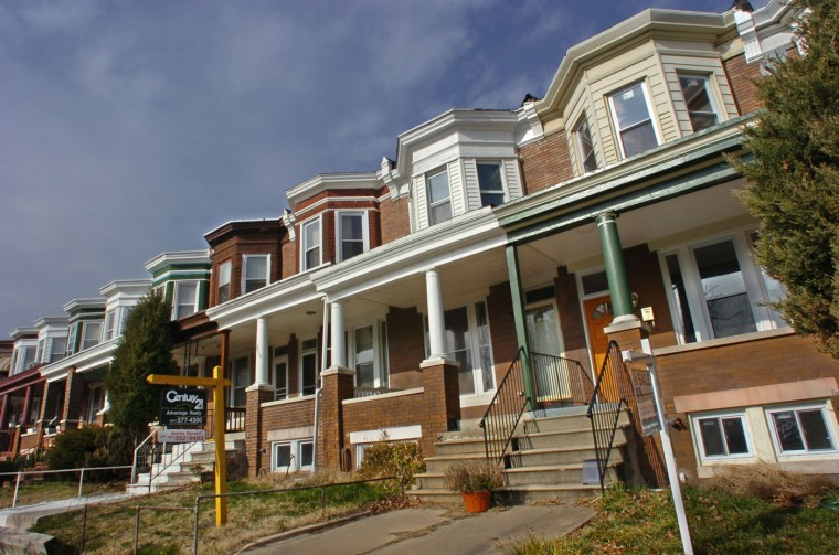 2/4/08: Arthur Jordan, 39, a real estate investor from Baltimore, has rehabbed a rowhouse in the 600 block of E. 35th St. in Waverly, at right, and had been trying to sell it for months. He was originally asking $249,950, but has since dropped the price to $220,000. (Amy Davis/Baltimore Sun)