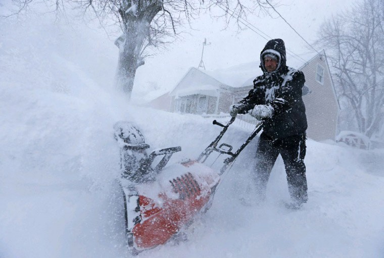 Snowfall in Depew, N.Y., was 3 and a half feet and counting Tuesday as George Urban Boulevard resident Wayne Manning used a blower to clear his driveway. (Derek Gee/Buffalo News)