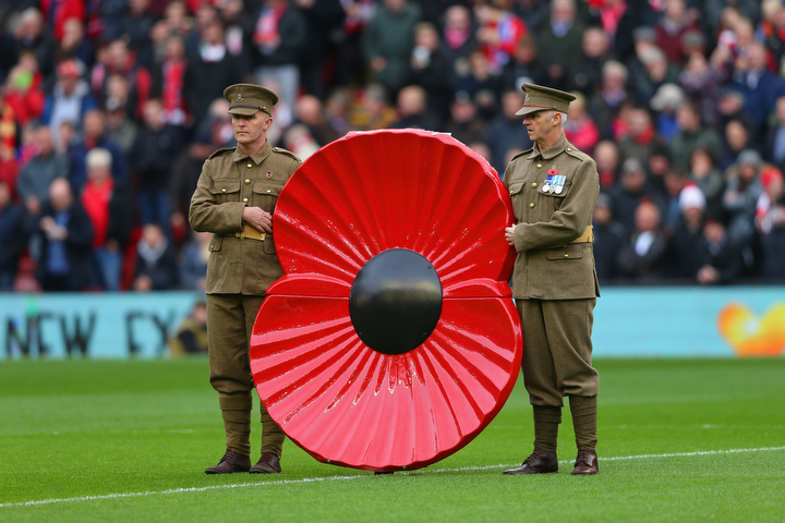 Military personnel mark Remembrance Day during the Barclays Premier League match between Liverpool and Chelsea at Anfield in Liverpool, England. (Alex Livesey/Getty Images)