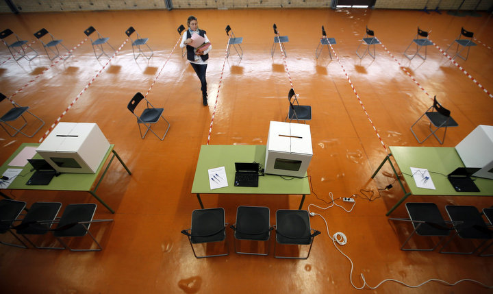"A volunteer makes preparations at a polling place for the 9N consultation in Sant Feliu de Llobregat, near Barcelona. Spanish Prime Minister Mariano Rajoy on Saturday called for renewed dialogue and a ""return to sanity"" in Catalonia as the region prepares to hold the symbolic vote on independence that is strongly opposed by the central government. (Albert Gea/Reuters)"