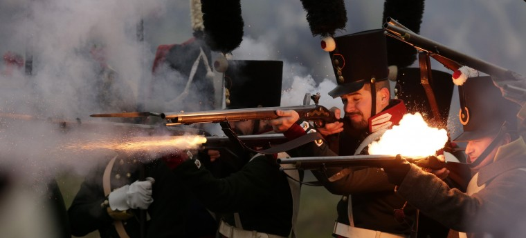 History enthusiasts, dressed as soldiers, fight during the re-enactment of Napoleon's famous battle of Austerlitz near the southern Moravian town of Slavkov u Brna. Hundreds of history enthusiasts took part in the re-enactment of the battle to mark its 209th anniversary. (David W Cerny/Reuters)