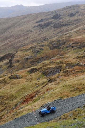 A competitor descends a hill during a vintage car rally stage at the Honister Slate Mine in the Lake District, England. The event, part of the Lakeland Trials, is held annually by the Vintage Sports Car Club and challenges drivers and their machines through hairpin bends and rocky terrain against a backdrop of awe-inspiring scenery. (Anna Gowthorpe/Getty Images)