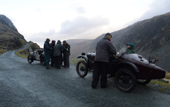 Competitors prepare for a vintage car rally stage at the Honister Slate Mine in the Lake District, England. The event, part of the Lakeland Trials, is held annually by the Vintage Sports Car Club and challenges drivers and their machines through hairpin bends and rocky terrain against a backdrop of awe-inspiring scenery. (Anna Gowthorpe/Getty Images)