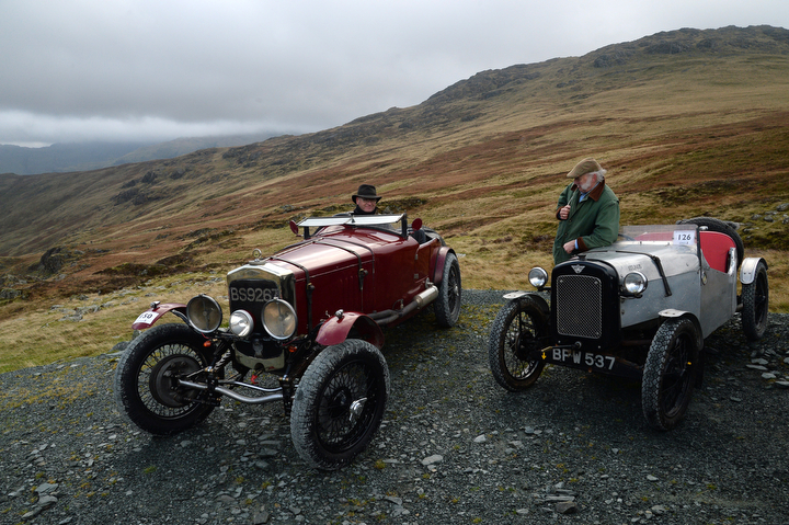 Competitors take a break at the top of the hill during a vintage car rally stage at the Honister Slate Mine in the Lake District, England. The event, part of the Lakeland Trials, is held annually by the Vintage Sports Car Club and challenges drivers and their machines through hairpin bends and rocky terrain against a backdrop of awe-inspiring scenery. (Anna Gowthorpe/Getty Images)