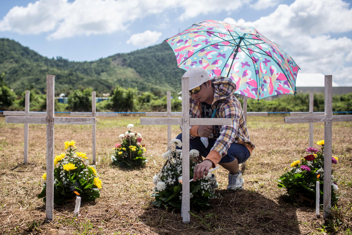 Willie Villarosa places candles at the grave of his sister and relatives and at the mass grave on the grounds of the Holy Cross Memorial Garden in Tacloban, Leyte, Philippines. Residents and typhoon survivors from across the central Philippines attended memorial services and visited mass graves honouring those who lost their lives one year ago when Typhoon Haiyan, the strongest typhoon ever to make landfall swept across the region, leaving more than 6000 dead and many more homeless. (Chris McGrath/Getty Images)