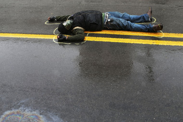 Demonstrators lay on the ground in a mock death protest of the shooting death of Michael Brown by a Ferguson police officer on November 16, 2014 in St. Louis, Missouri. The area around St Louis, Missouri prepares for the grand jury decision in the shooting death of Michael Brown by Darren Wilson, a Ferguson police officer. (Photo by Joe Raedle/Getty Images)