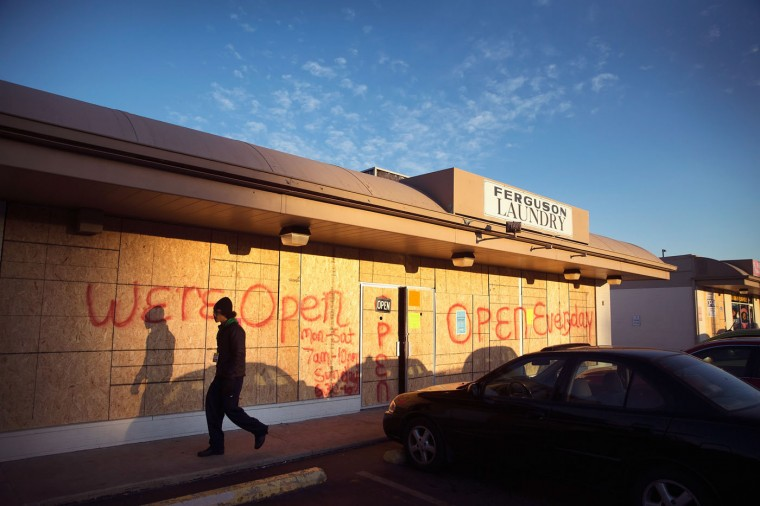 Plywood covers the glass front of a strip mall along West Florissant Street on November 14, 2014 in Ferguson, Missouri. Many businesses along West Florissant are boarded-up as residents prepare for the grand jury decision in the shooting death of Michael Brown. Many of the stores along the street were looted and vandalized during rioting which broke out after Brown was killed by Darren Wilson, a Ferguson police officer. The city is hoping to avoid a repeat of those riots if the grand jury investigating the shooting does not find justification to prosecute Wilson. The grand jurys decision is expected sometime in November. (Photo by Scott Olson/Getty Images)