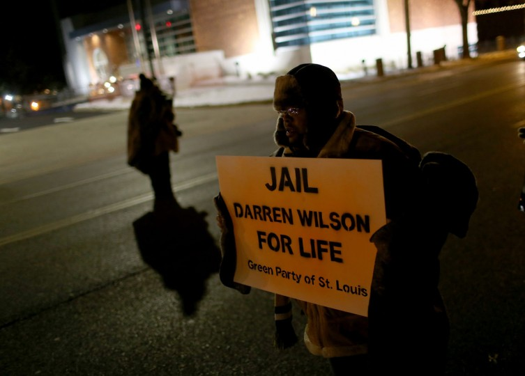 Demonstrators gather across the street from the Ferguson police station to protest the shooting death of Michael Brown by a Ferguson police officer on November 16, 2014 in St. Louis, Missouri. The area around St Louis, Missouri prepares for the grand jury decision in the shooting death of Michael Brown by Darren Wilson, a Ferguson police officer. (Photo by Joe Raedle/Getty Images)
