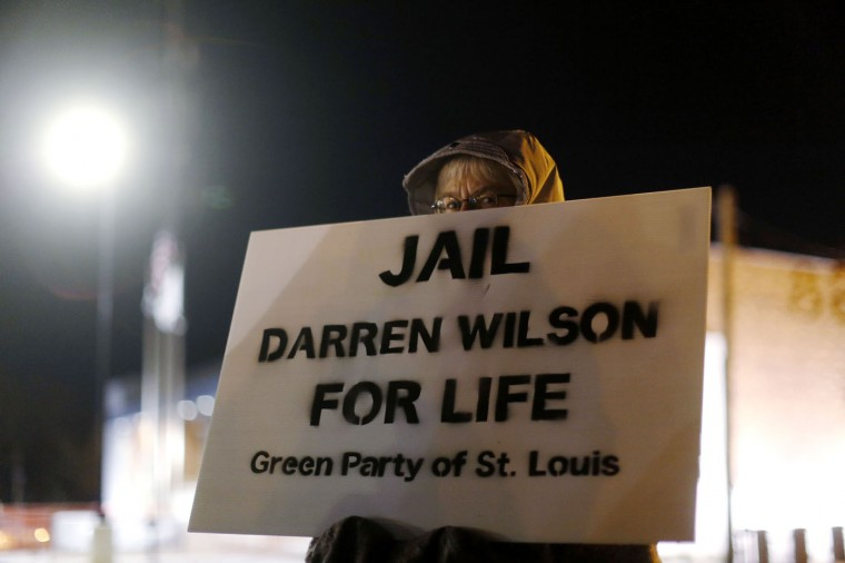 A demonstrator protests over the shooting death of Michael Brown in front of the Ferguson Police Department in Ferguson, Missouri, November 17, 2014. Missouri's governor declared a state of emergency on Monday and authorized the state's National Guard to support police in case of violence after a grand jury decides whether to indict Darren Wilson, a white police officer who fatally shot unarmed black teenager Brown. (Jim Young/Reuters)