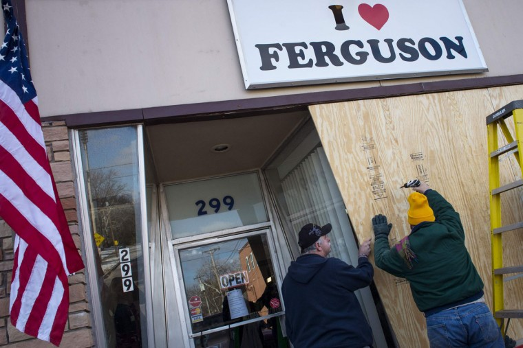 "Volunteers board up the ""I Love Ferguson"" headquarters in preparation for the grand jury verdict in the shooting death of Michael Brown in Ferguson, Missouri, November 18, 2014. The grand jury is expected to reach a decision this month on whether to indict Darren Wilson, the white police officer who shot and killed the 18-year-old Brown, who was black, on Aug. 9 in the St. Louis suburb of Ferguson. (Kate Munsch/Reuters)"