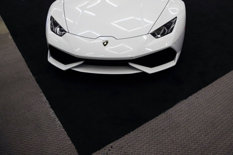 A Lamborghini is seen during preparations for the 2014 LA Auto Show in Los Angeles, California November 18, 2014. (Lucy Nicholson/Reuters)