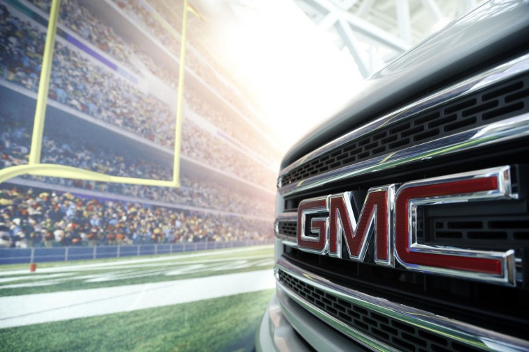 A GMC logo is seen during preparations for the 2014 LA Auto Show in Los Angeles, California November 18, 2014. (Lucy Nicholson/Reuters)