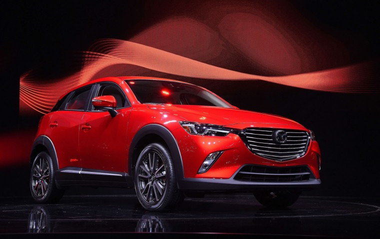 The Mazda CX-3 Crossover is unveiled at the Los Angeles Auto Show, November 19, 2014 in Los Angeles, California. Robyn Beck/AFP/Getty Images)