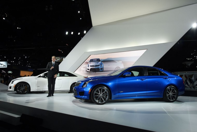 Cadillac President Johan de Nysschen unveils the Cadillac 2016 ATS-V coupe(L)and sedan, at the LA Auto Show media day, November 19, 2014 in Los Angeles, California. (Robyn Beck/AFP/Getty Images)