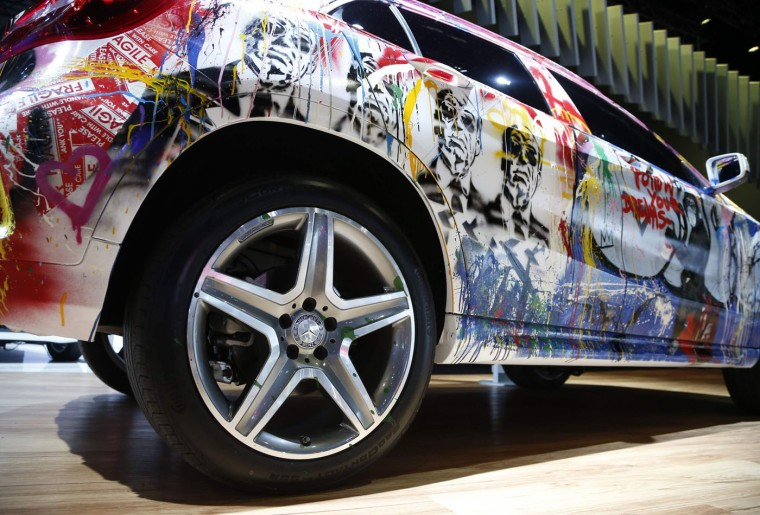 The Mercedes Benz Evolution Tour GLA, which sports a graffiti paint job, is shown on display at the Los Angeles Auto Show in Los Angeles, California November 19, 2014. (Lucy Nicholson/Reuters)