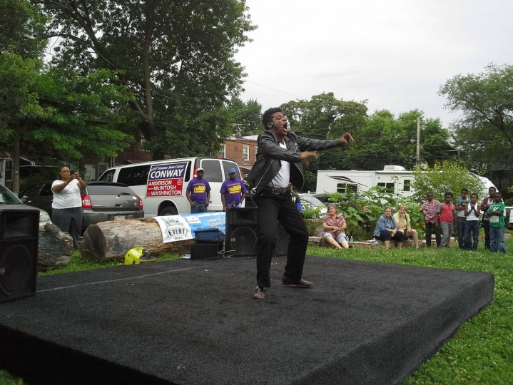"6/21/14: Street performer Dimitri Reeves dances to the Michael Jackson song ""Beat It,"" during the second annual Wavescape festival in Waverly on Saturday. A crowd of more than 100 people sang ""Happy Birthday"" to City Councilwoman Mary Pat Clarke, who was turning 73 the next day."