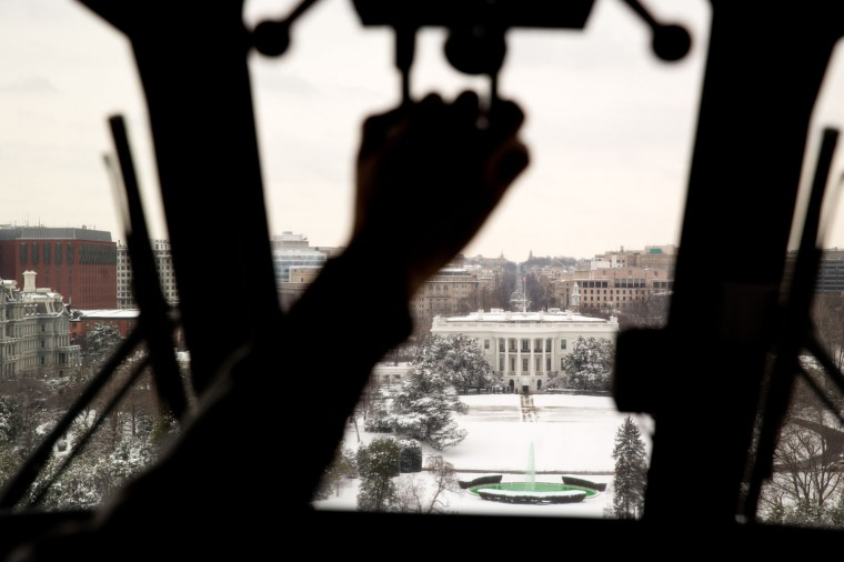 "March 17, 2014 ""Returning from a visit to Walter Reed National Military Medical Center in Bethesda, Maryland, I asked the pilots of the Marine One helicopter if I could photograph from the cockpit as we approached the White House."" (Official White House Photo by Pete Souza)"