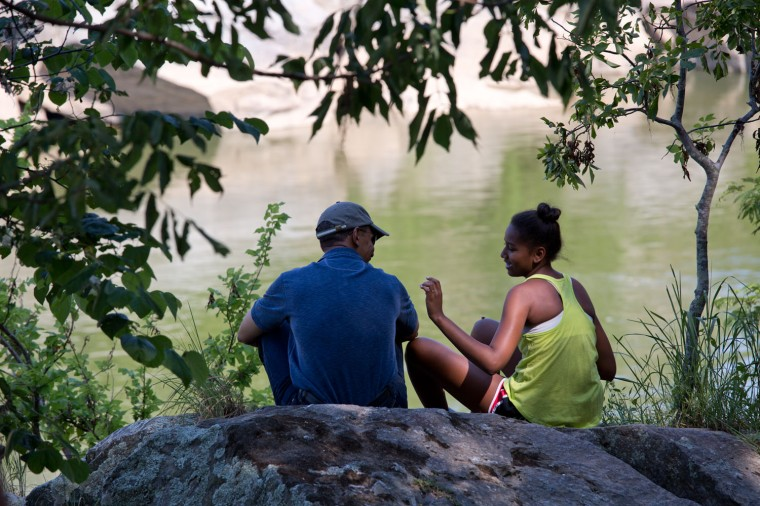 "June 29, 2014 ""The President shares a quiet moment with his daughter Sasha during a father and daughter hike at Great Falls, Virginia."" (Official White House Photo by Pete Souza)"