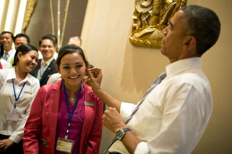 "Nov. 13, 2014 ""The President was shopping for family gifts with local vendors at a hotel in Naypyitaw, Burma. When he found some earrings he thought would be good for his daughter Malia, he sought out a hotel employee to see how they might look."" (Official White House Photo by Pete Souza)"