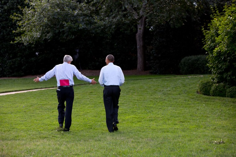 "Sept. 22, 2014 ""It's called 'Wrap with Denis' on the schedule. The end of the day meeting between the President and Chief of Staff Denis McDonough often turns into a walk on the South Grounds of the White House. And Denis usually carries a red folder with him."" (Official White House Photo by Pete Souza)"