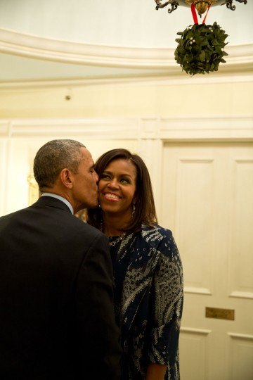"Dec. 3, 2014 ""The First Lady and I both spotted the President standing under the mistletoe and she moved in to grab a kiss from him following a dinner for Combatant Commanders and military leadership at Blair House in Washington, D.C."" (Official White House Photo by Pete Souza)"