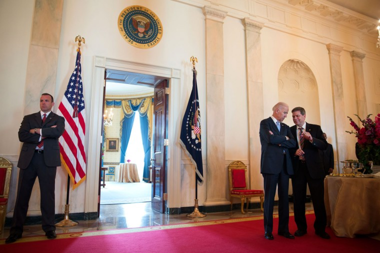 "June 25, 2014 ""The Vice President talks to Alaska Senator Mark Begich during the President's reception with Senate Democrats in the Cross Hall of the White House."" (Official White House Photo by David Lienemann)"