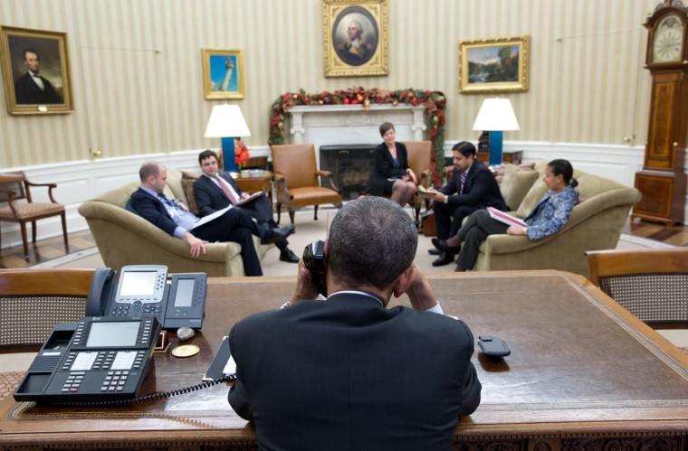 "Dec. 16, 2014 ""The President talks on the phone with President Raœl Castro of Cuba in the Oval Office. The next day, the President announced the U.S. would restore full relations with Cuba after more than 50 years."" (Official White House Photo by Pete Souza)"