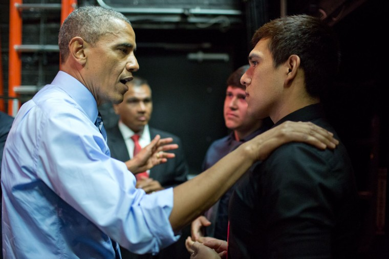 "July 10, 2014 ""During remarks on the economy in Austin, Texas, the President was heckled about immigration by two young men in the audience. After being interrupted again, the President told the men that he wanted to finish his speech but would be happy to have a conversation with them later. As soon as he left the stage, the President told his staff to bring the two men backstage so he could indeed talk to them about immigration."" (Official White House Photo by Pete Souza)"