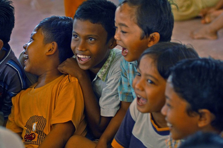 Young boys pressed against each other enjoy a good laugh as they play at Camp MNS Desa Lamgugop Monday, Jan. 17 2005. Save The Children has begun sponsoring safe spaces for the children, who have been victimized by a tsunami that swept through the town in December. (Karl Merton Ferron, Baltimore Sun)