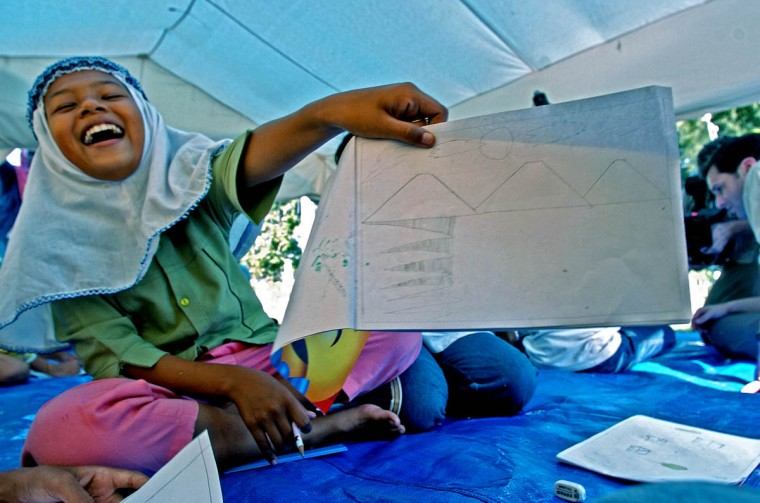 Humaira Puspitadewi, 11 shows off her incomplete sketch of Banda Aceh during school at Darussalem. (Karl Merton Ferron, Baltimore Sun)