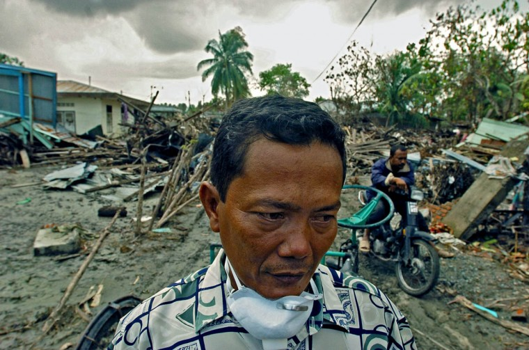 Kepala Desa Hamdani, Dukoh's village leader looks off as he ingests the gravity of the plight of Acehnese following the devastation from the tsunami Friday, Jan. 14, 2004. Residents of Banda Aceh, which suffered one of the worst disasters in modern history after half of the town was wiped out by an earthquake and tsunami, struggle to right themselves in an area already financially struggling. (Karl Merton Ferron, Baltimore Sun)