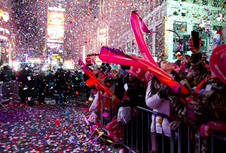 Revelers are engulfed by confetti in Times Square just after midnight during New Year's Eve festivities in New York, Thursday, Jan. 1, 2015. (Craig Ruttle/AP photo)