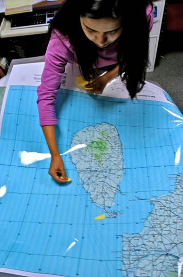Chadreyee Banerjee of Catholic Relief Services marks places where the CRS is operational in Sri Lanka at CRS Wednesday, Jan. 5, 2005. (Karl Merton Ferron, Baltimore Sun)