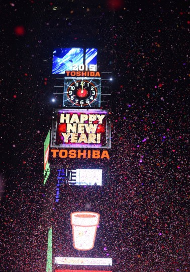 People cheer as the ball drops at midnight in Times Square on January 1, 2015 in New York City. An estimated one million people from around the world are expected to pack Times Square to ring in 2015. (Andrew Theodorakis/Getty Images)