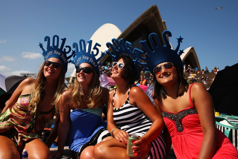 People gather at the Sydney Opera House to welcome in the new year on New Year's Eve on Sydney Harbour on December 31, 2014 in Sydney, Australia. (Photo by Brendon Thorne/Getty Images)