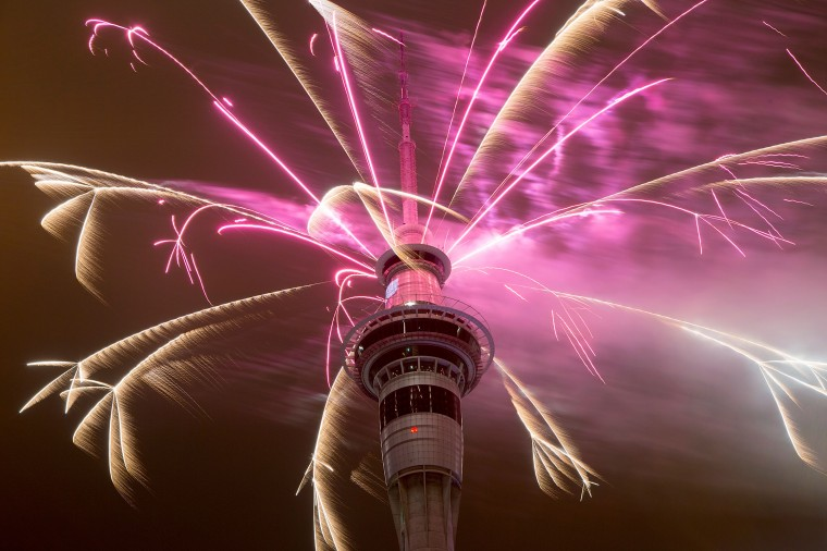 Firework display from the top of the Sky Tower to welcome the New Year on January 1, 2015 in Auckland, New Zealand. (Photo by Dave Rowland/Getty Images)