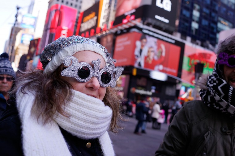 Revellers wait in Times Square on December 31, 2014 in New York City. An estimated one million people from around the world are expected to pack into Times Square to ring in 2015. (Photo by Spencer Platt/Getty Images)