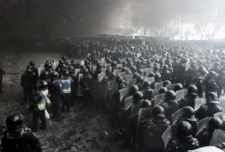 Riot police officers gather as they clash with protestors in the center of Kiev on January 22, 2014. Ukrainian police today stormed protesters' barricades in Kiev as violent clashes erupted and activists said that one person had been shot dead by the security forces. Total of two activists shot dead during clashing. The move by police increased tensions to a new peak after two months of protests over President Viktor Yanukovych's failure to sign a deal for closer ties with the EU. Antoli Boiko/AFP/Getty Images